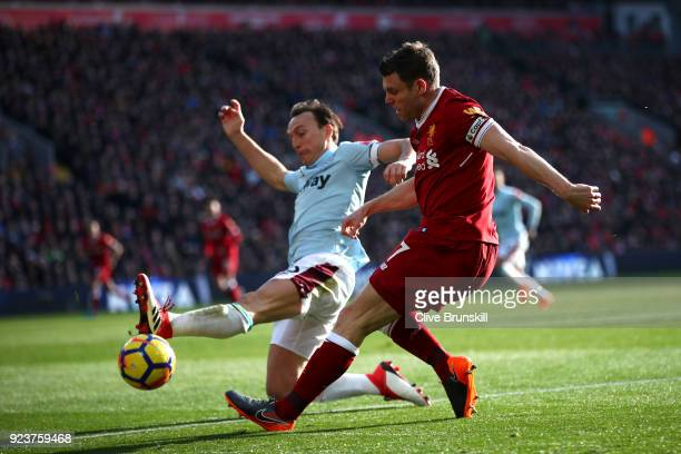 Mark Noble of West Ham United battles for possesion with James Milner of Liverpool during the Premier League match between Liverpool and West Ham...