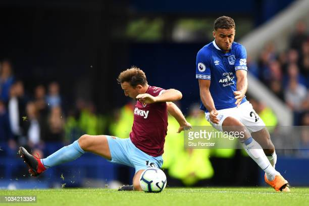 Mark Noble of West Ham United battles for possession with Dominic CalvertLewin of Everton during the Premier League match between Everton FC and West...