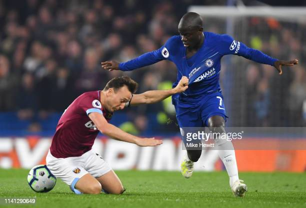 Mark Noble of West Ham United battles with N'golo Kante of Chelsea during the Premier League match between Chelsea FC and West Ham United at Stamford...