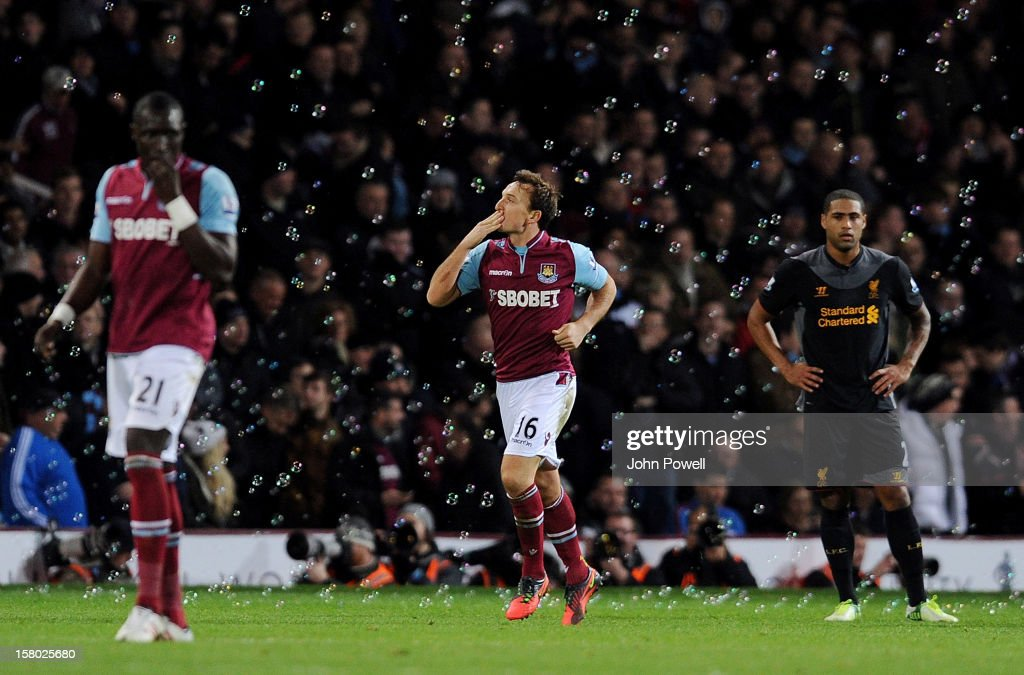 Mark Noble of West Ham United celebrates after scoring a penalty during the Barclays Premier League match between West Ham United and Liverpool at Boleyn Ground on December 9, 2012 in London, England.
