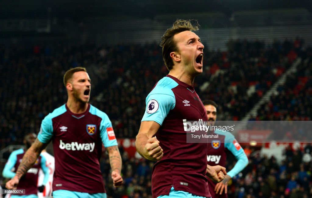 Mark Noble of West Ham United celebrates after scoring his sides first goal during the Premier League match between Stoke City and West Ham United at Bet365 Stadium on December 16, 2017 in Stoke on Trent, England.