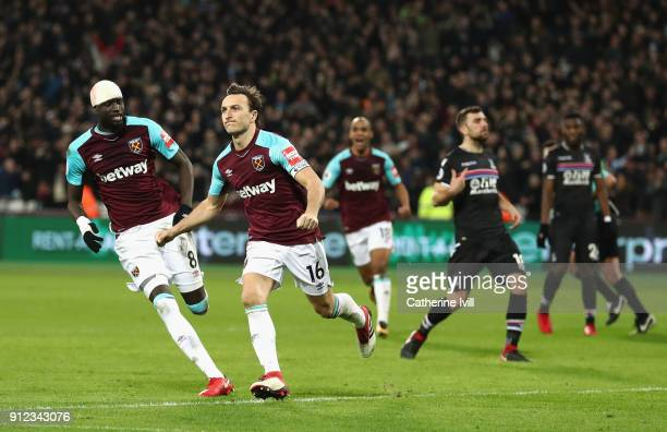 Mark Noble of West Ham United celebrates after scoring his sides first goal during the Premier League match between West Ham United and Crystal...