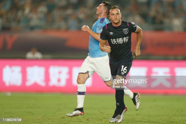 Mark Noble of West Ham United celebrates after scoring his team's goal during Premier League Asia Trophy West Ham United v Manchester City on July 17...