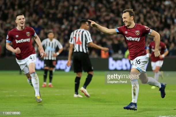 Mark Noble of West Ham United celebrates after scoring his team's second goal during the Premier League match between West Ham United and Newcastle...
