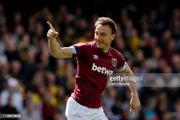 Mark Noble of West Ham United celebrates after scoring his team's first goal during the Premier League match between Watford FC and West Ham United...