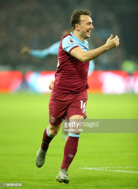 Mark Noble of West Ham United celebrates after scoring his team's first goal during the Premier League match between West Ham United and AFC...