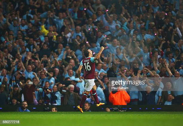 Mark Noble of West Ham United celebrates in front of fans as Michail Antonio of West Ham United scores their second and equalising goal during the...