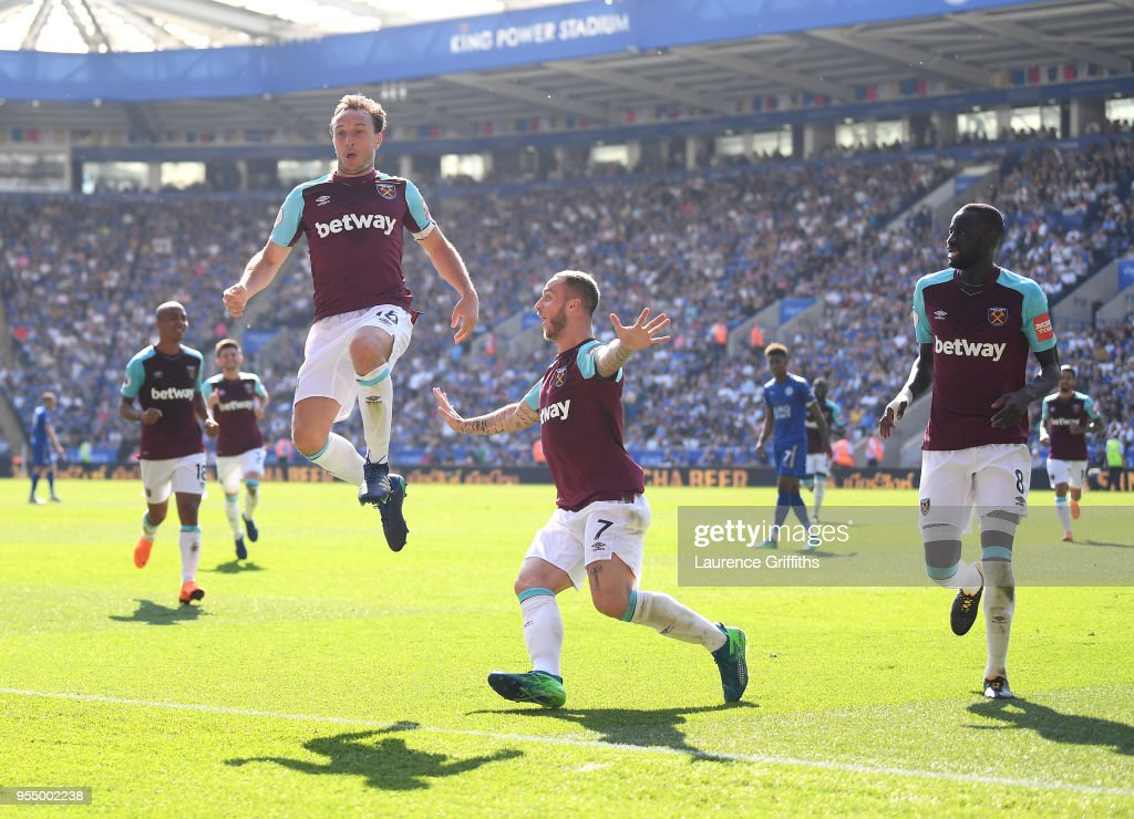 Mark Noble of West Ham United celebrates scoring his side's second goal with team mates Marko Arnautovic and Cheikhou Kouyate during the Premier League match between Leicester City and West Ham United at The King Power Stadium on May 5, 2018 in Leicester, England.