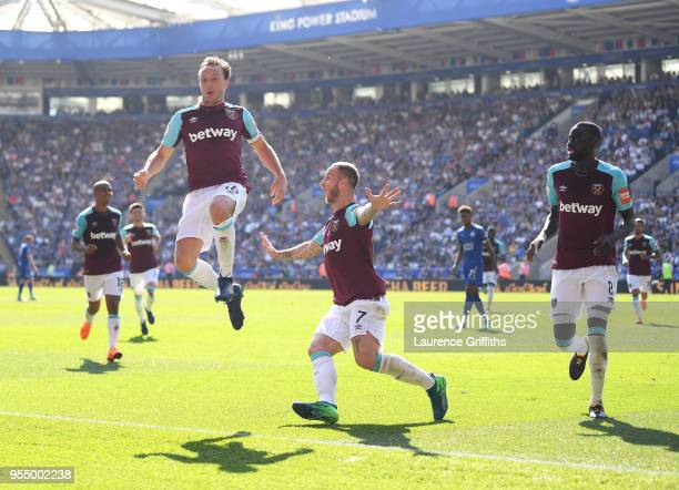 Mark Noble of West Ham United celebrates scoring his side's second goal with team mates Marko Arnautovic and Cheikhou Kouyate during the Premier...