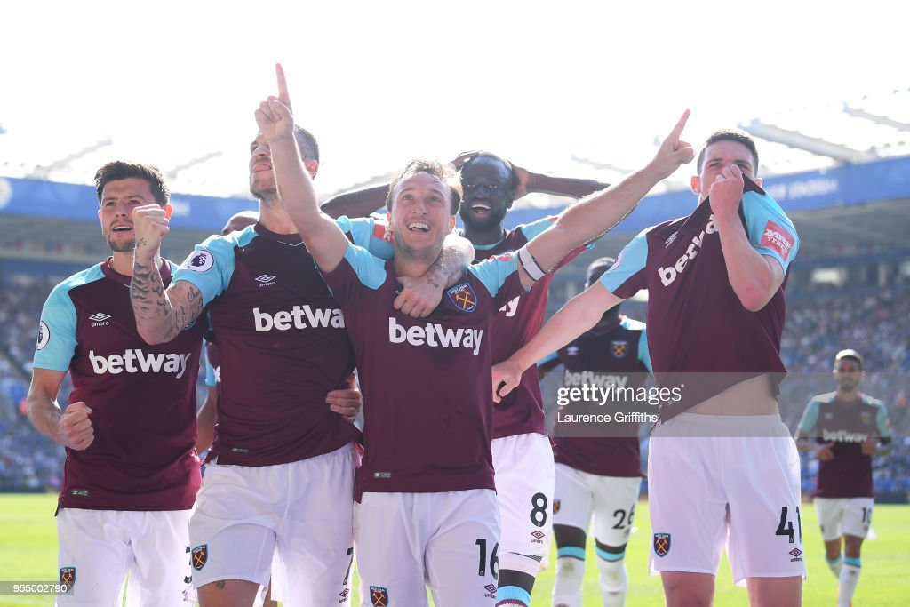 Mark Noble of West Ham United celebrates scoring his side's second goal with team mates during the Premier League match between Leicester City and West Ham United at The King Power Stadium on May 5, 2018 in Leicester, England.