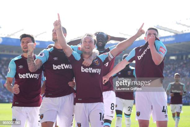 Mark Noble of West Ham United celebrates scoring his side's second goal with team mates during the Premier League match between Leicester City and...