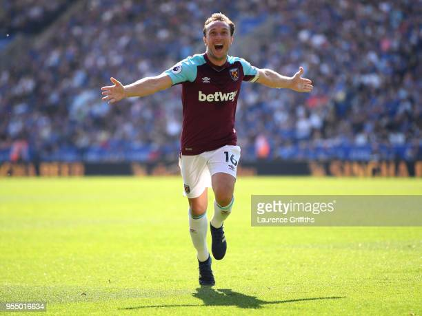 Mark Noble of West Ham United celebrates scoring his side's second goal during the Premier League match between Leicester City and West Ham United at...