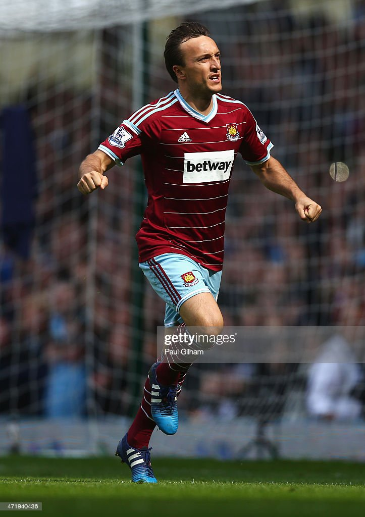 Mark Noble of West Ham United celebrates scoring his team's first goal from the penalty spot during the Barclays Premier League match between West Ham United and Burnley at the Boleyn Ground on May 2, 2015 in London, England.