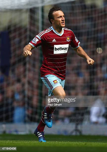 Mark Noble of West Ham United celebrates scoring his team's first goal from the penalty spot during the Barclays Premier League match between West...
