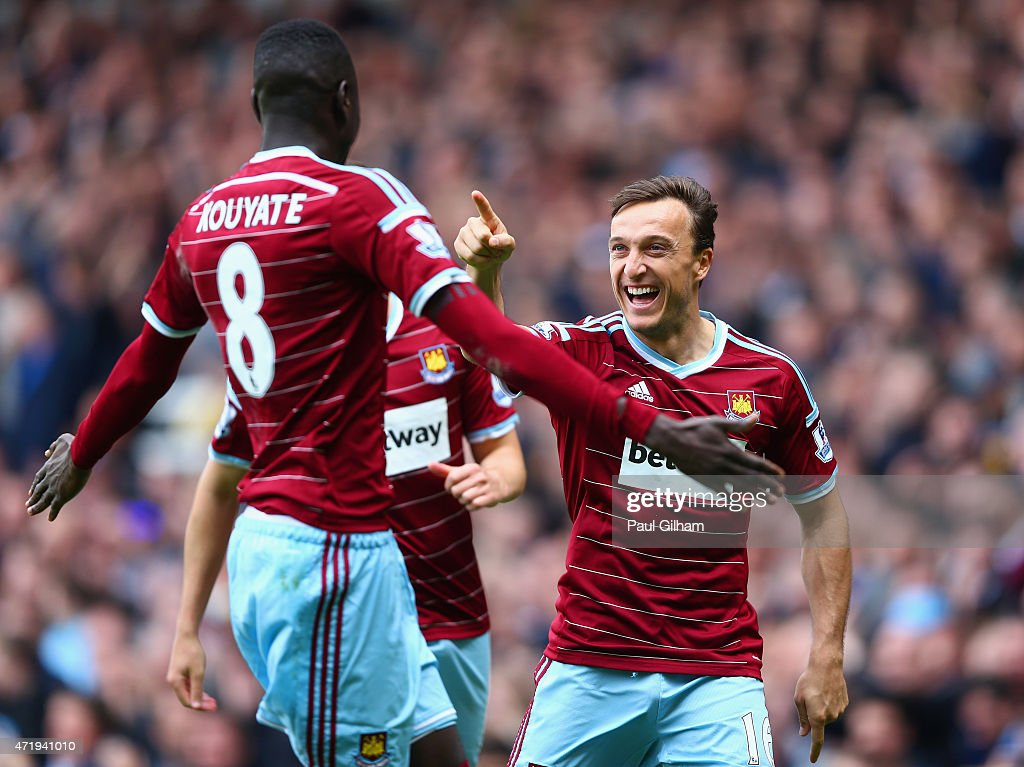 Mark Noble of West Ham United celebrates scoring his team's first goal from the penalty spot with his team mate Cheikhou Kouyate during the Barclays Premier League match between West Ham United and Burnley at the Boleyn Ground on May 2, 2015 in London, England.
