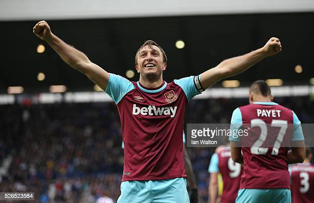 Mark Noble of West Ham United celebrates scoring his team's third goal during the Barclays Premier League match between West Bromwich Albion and West...