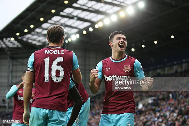 Mark Noble of West Ham United celebrates scoring his team's third goal with his team mate Aaron Cresswell during the Barclays Premier League match...