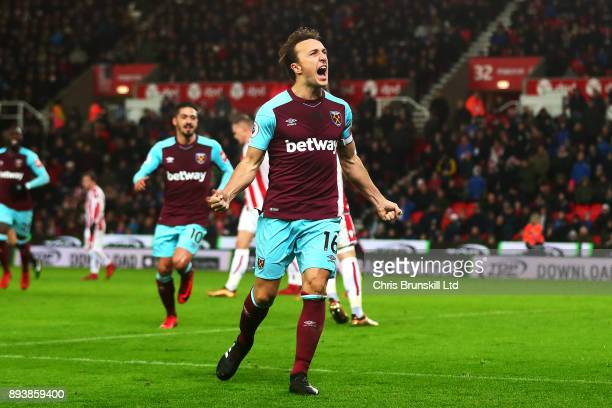 Mark Noble of West Ham United celebrates scoring the opening goal from the penalty spot during the Premier League match between Stoke City and West...