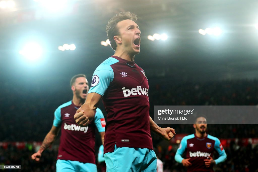 Mark Noble of West Ham United celebrates scoring the opening goal from the penalty spot during the Premier League match between Stoke City and West Ham United at Bet365 Stadium on December 16, 2017 in Stoke on Trent, England.