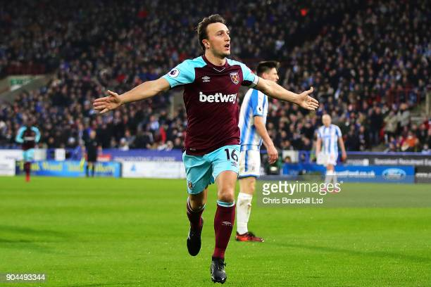 Mark Noble of West Ham United celebrates scoring the opening goal during the Premier League match between Huddersfield Town and West Ham United at...