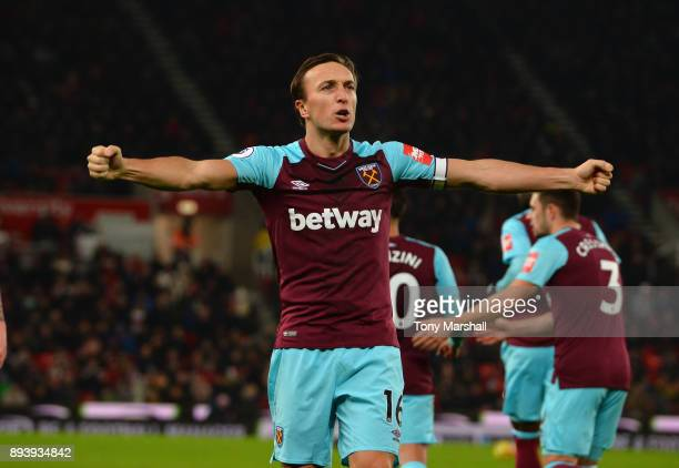 Mark Noble of West Ham United celebrates scoring their first goal from the penalty spot during the Premier League match between Stoke City and West...