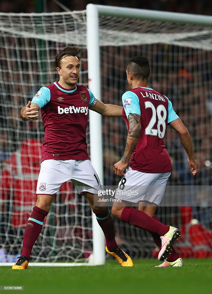 Mark Noble of West Ham United celebrates with Manuel Lanzini of West Ham United after scoring his sides second goal during the Barclays Premier League match between West Ham United and Watford at the Boleyn Ground, April 20, 2016, London, England