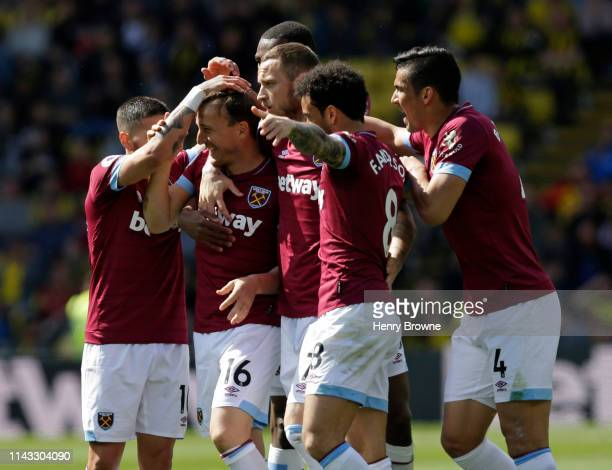 Mark Noble of West Ham United celebrates with team mates after scoring their first goal during the Premier League match between Watford FC and West...