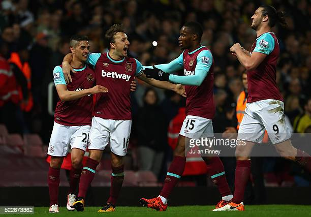 Mark Noble of West Ham United celebrates with team mates following scoring his sides second goal during the Barclays Premier League match between...