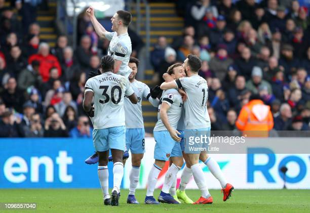 Mark Noble of West Ham United celebrates with teammates after scoring his team's first goal during the Premier League match between Crystal Palace...