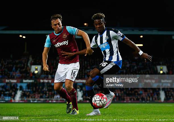 Mark Noble of West Ham United challenges Rolando Aarons of Newcastle United during the Barclays Premier League match between West Ham United and...
