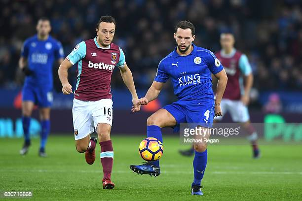 Mark Noble of West Ham United closes down Daniel Drinkwater of Leicester City during the Premier League match between Leicester City and West Ham...