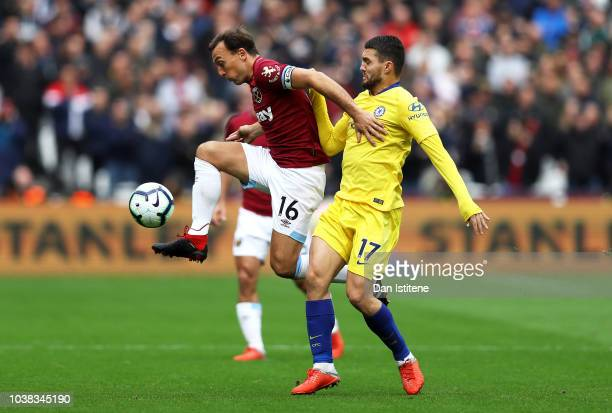Mark Noble of West Ham United controls the ball under pressure from Mateo Kovacic of Chelsea during the Premier League match between West Ham United...
