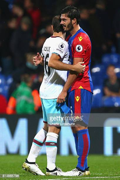 Mark Noble of West Ham United embraces former West Ham player James Tomkins of Crystal Palace after the Premier League match between Crystal Palace...