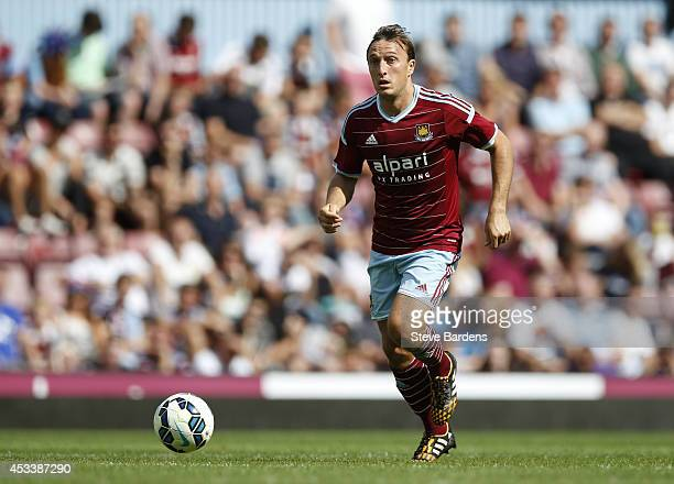 Mark Noble of West Ham United in action during the preseason friendly match between West Ham United and Sampdoria at Boleyn Ground on August 9 2014...