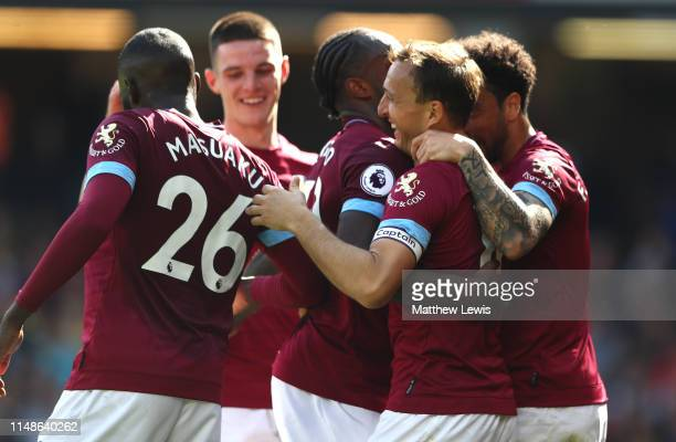 Mark Noble of West Ham United is congratulated on his second goal during the Premier League match between Watford FC and West Ham United at Vicarage...