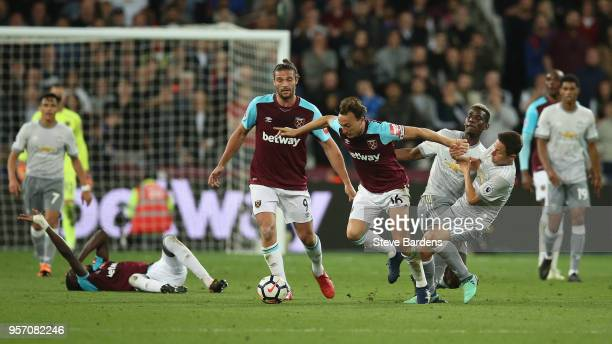 Mark Noble of West Ham United is fouled by Ander Herrera of Manchester United during the Premier League match between West Ham United and Manchester...