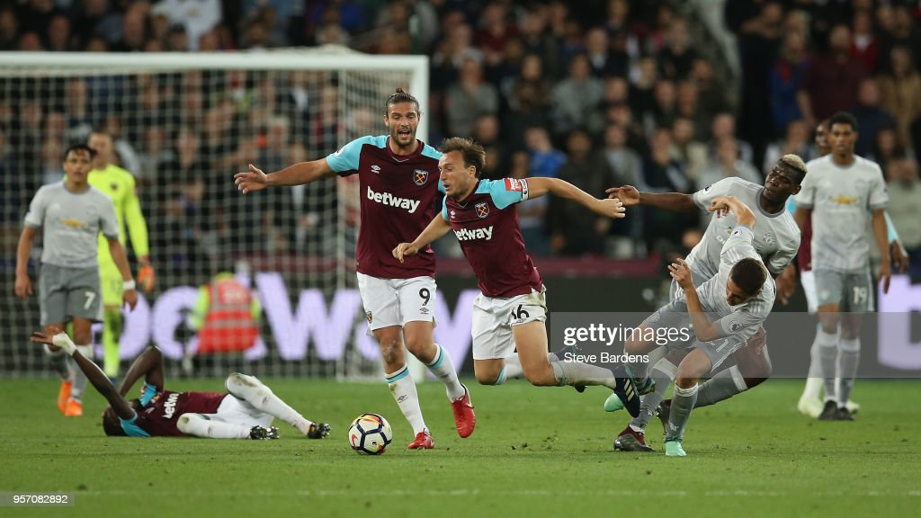 Mark Noble of West Ham United is fouled by Ander Herrera of Manchester United during the Premier League match between West Ham United and Manchester United at London Stadium on May 10, 2018 in London, England.