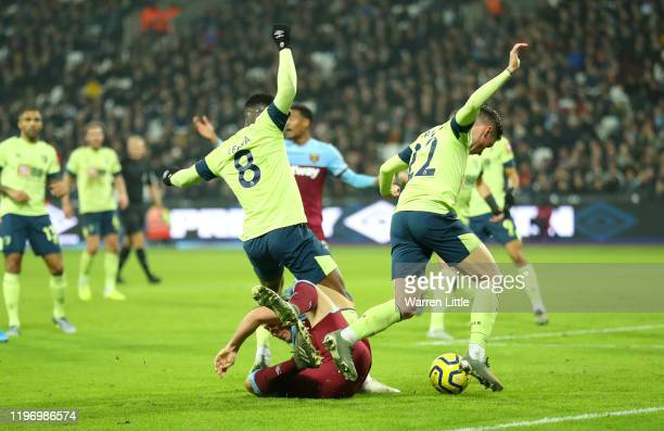 Mark Noble of West Ham United is fouled by Harry Wilson and Jefferson Lerma of AFC Bournemouth and a penalty is later awarded during the Premier...