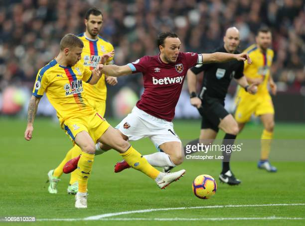 Mark Noble of West Ham United is fouled by Max Meyer of Crystal Palace during the Premier League match between West Ham United and Crystal Palace at...