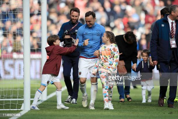 Mark Noble of West Ham United is seen with his children during a lap of appreciaiton after the Premier League match between West Ham United and...