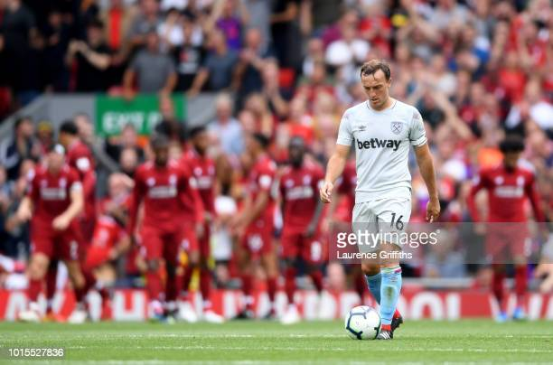 Mark Noble of West Ham United looks dejected following Liverpool's second goal during the Premier League match between Liverpool FC and West Ham...