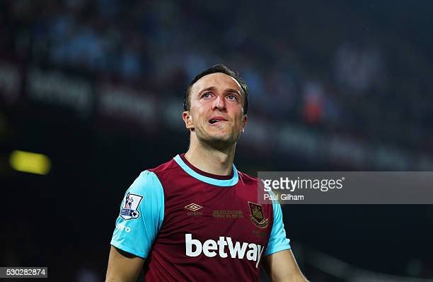 Mark Noble of West Ham United looks thoughtful after the Barclays Premier League match between West Ham United and Manchester United at the Boleyn...