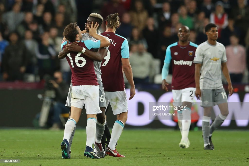 Mark Noble of West Ham United puts his hands around the throat of Paul Pogba of Manchester United during the Premier League match between West Ham United and Manchester United at London Stadium on May 10, 2018 in London, England.
