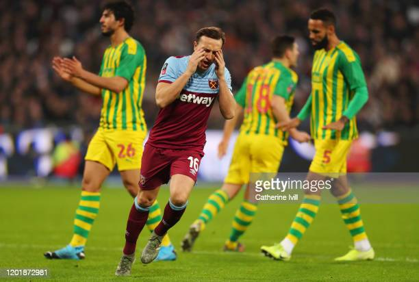 Mark Noble of West Ham United reacts after a missed chance during the FA Cup Fourth Round match between West Ham United and West Bromwich Albion at...