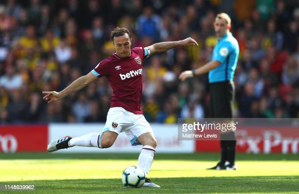 Mark Noble of West Ham United scores a goal from the penalty spot during the Premier League match between Watford FC and West Ham United at Vicarage...