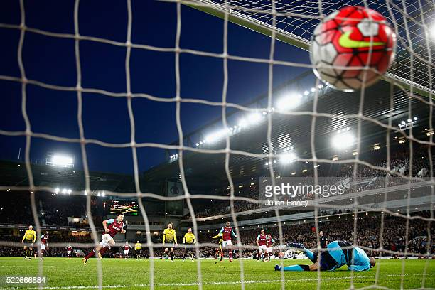Mark Noble of West Ham United scores a penalty as Heurelho Gomes of Watford goes the wrong way during the Barclays Premier League match between West...