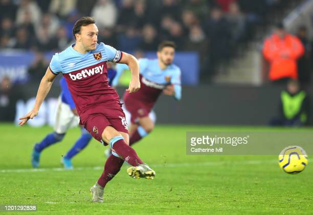 Mark Noble of West Ham United scores his sides first goal during the Premier League match between Leicester City and West Ham United at The King...