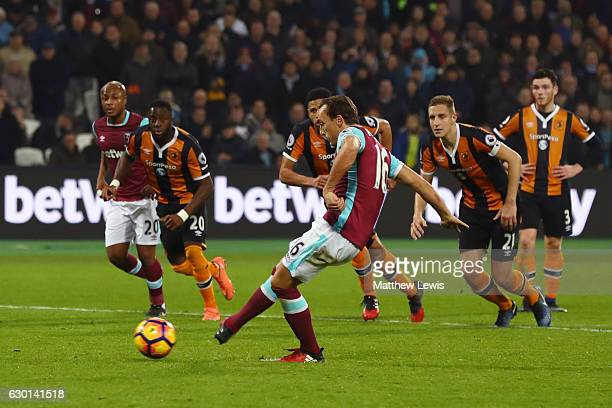 Mark Noble of West Ham United scores his sides first goal from the penalty spot during the Premier League match between West Ham United and Hull City...