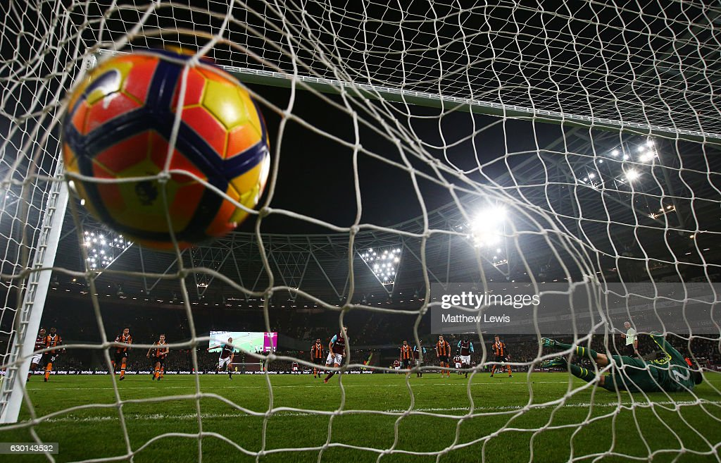 Mark Noble of West Ham United (C) scores his sides first goal from the penalty spot during the Premier League match between West Ham United and Hull City at London Stadium on December 17, 2016 in Stratford, England.