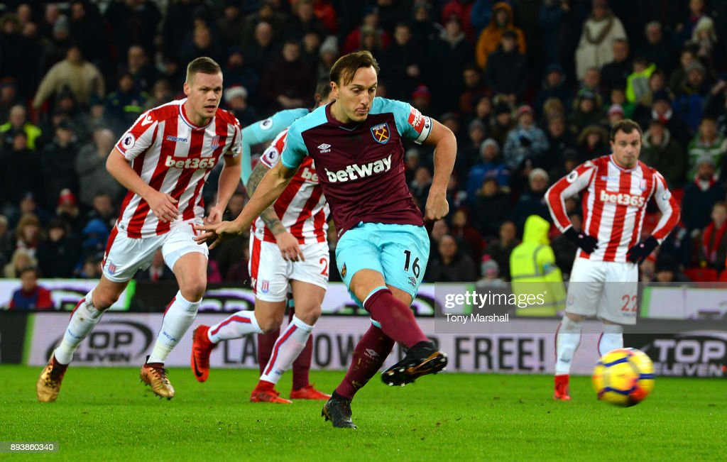 Mark Noble of West Ham United scores his sides first goal from the penalty spot during the Premier League match between Stoke City and West Ham United at Bet365 Stadium on December 16, 2017 in Stoke on Trent, England.